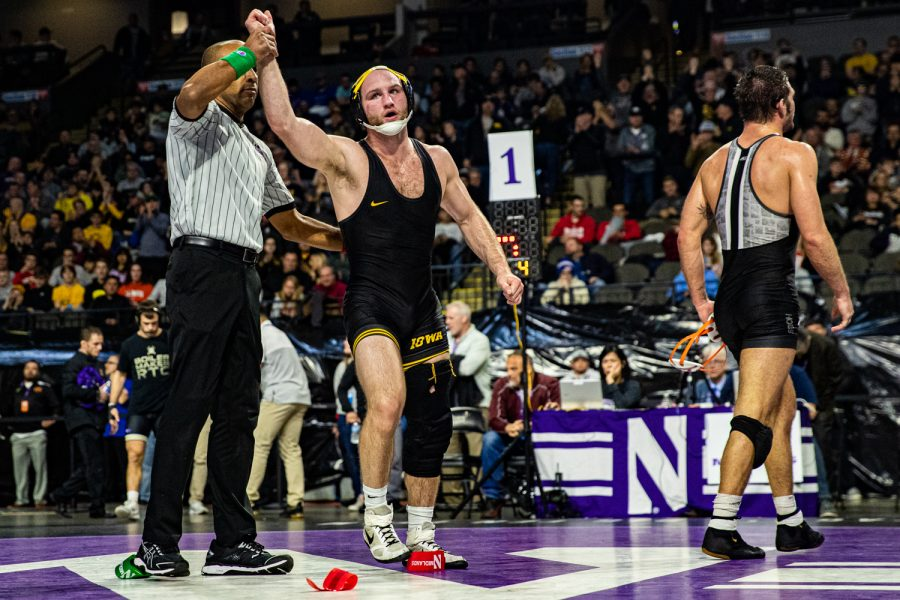 Iowa%E2%80%99s+165-pound+Alex+Marinelli+wrestles+Virginia+Tech%E2%80%99s+David+McFadden+during+the+fourth+session+of+the+57th+Annual+Ken+Kraft+Midlands+Championships+at+the+Sears+Centre+in+Hoffman+Estates%2C+IL%2C+on+Monday%2C+Dec.+30%2C+2019.+Marinelli+won+by+decision%2C+5-3%2C+and+placed+first+in+the+weight+class.