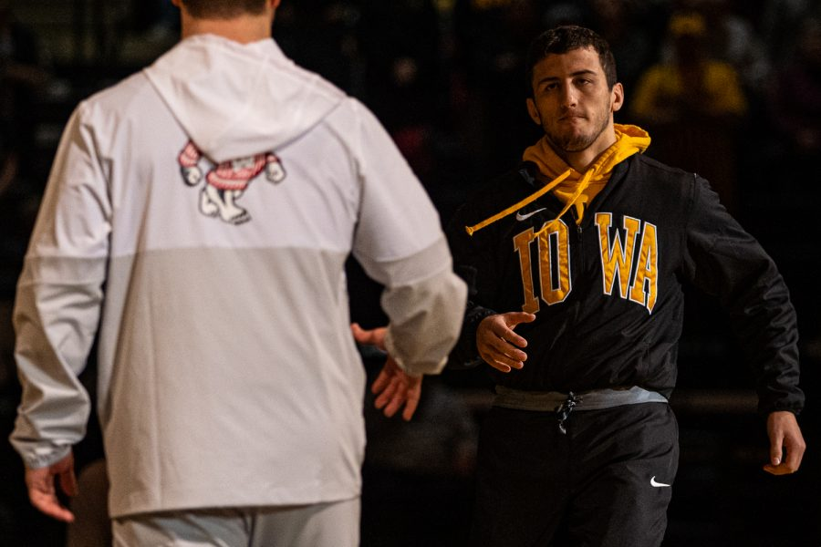 Wrestlers+are+introduced+during+a+wrestling+match+between+No.1+Iowa+and+No.+6+Wisconsin+at+Carver-Hawkeye+Arena+on+Sunday%2C+Dec.+1%2C+2019.+The+Hawkeyes+defeated+the+Badgers%2C+32-3.