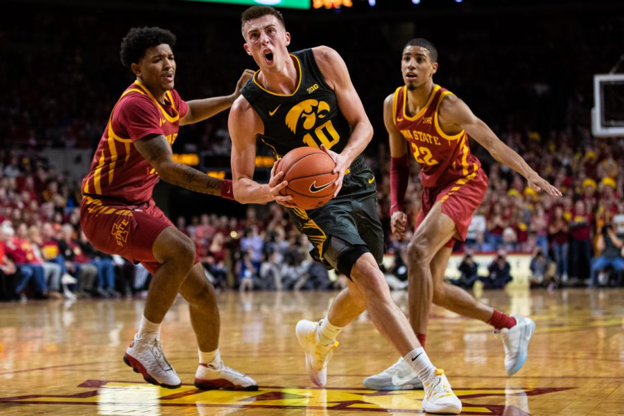 Iowa+guard+Joe+Wieskamp+drives+to+the+rim+during+a+men%C3%95s+basketball+match+between+Iowa+and+Iowa+State+at+Hilton+Coliseum+on+Thursday%2C+Dec.+12%2C+2019.+Wieskamp+finished+with+13+points.