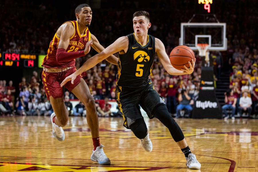 Iowa guard CJ Fredrick drives to the net during a menÕs basketball match between Iowa and Iowa State at Hilton Coliseum on Thursday, Dec. 12, 2019. Fredrick played for 32:15.