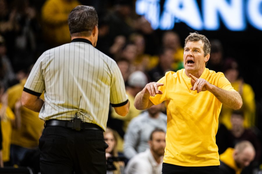 Iowa head coach Tom Brands confronts the officials during a wrestling match between No.1 Iowa and No. 6 Wisconsin at Carver-Hawkeye Arena on Sunday, Dec. 1, 2019. The Hawkeyes defeated the Badgers, 32-3.