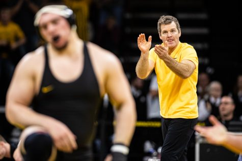 Iowa head coach Tom Brands watches his team in action during a wrestling match between No.1 Iowa and No. 6 Wisconsin at Carver-Hawkeye Arena on Sunday, Dec. 1, 2019. The Hawkeyes defeater the Badgers, 32-3.