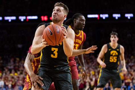 Iowa guard Jordan Bohannon looks to the backboard during a menÕs basketball match between Iowa and Iowa State at Hilton Coliseum on Thursday, Dec. 12, 2019. Bohannon finished with 12 points.