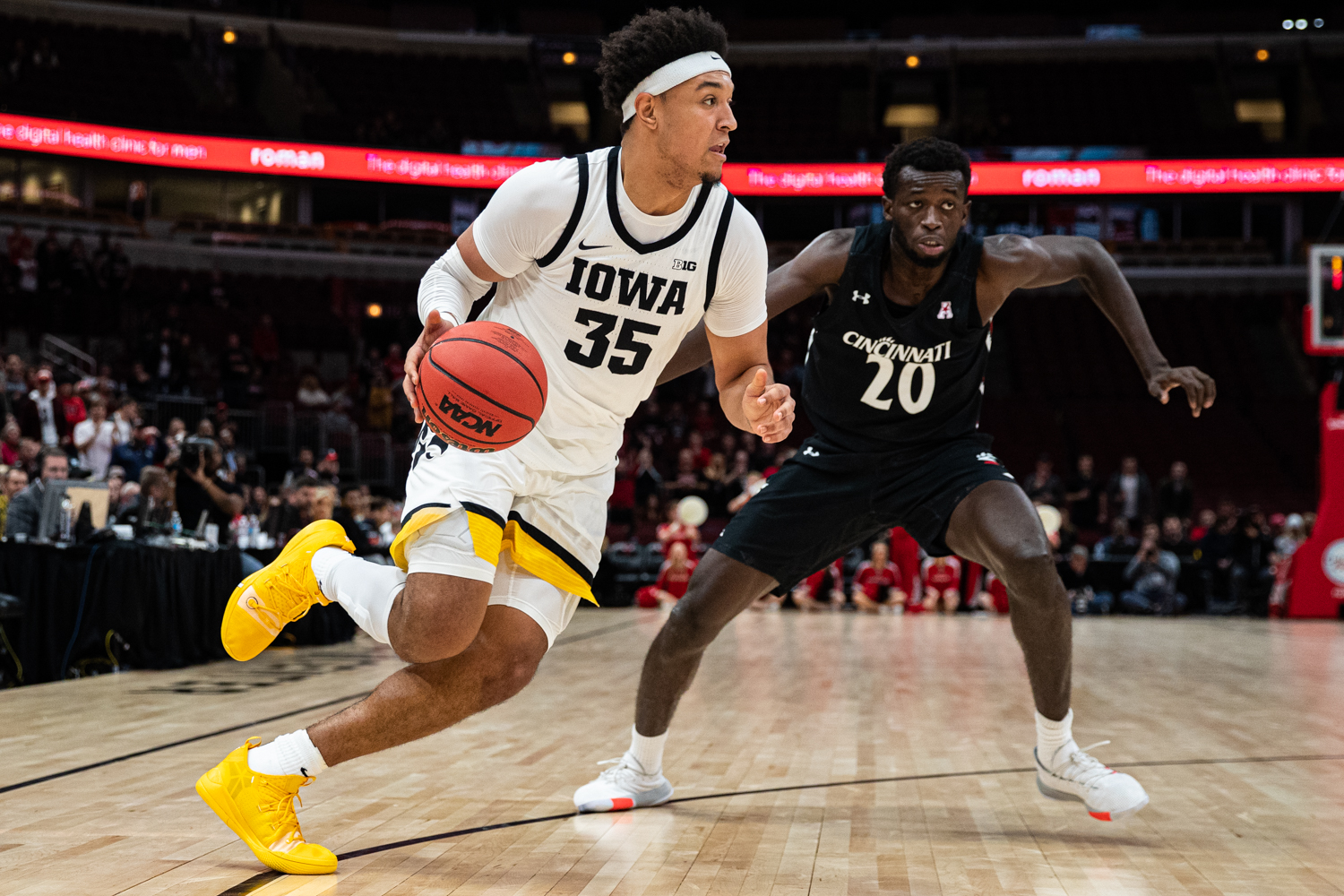 Iowa forward Cordell Pemsl dribbles during a men's basketball match between Iowa and Cincinnati at the United Center in Chicago on Saturday, Dec. 21, 2019.