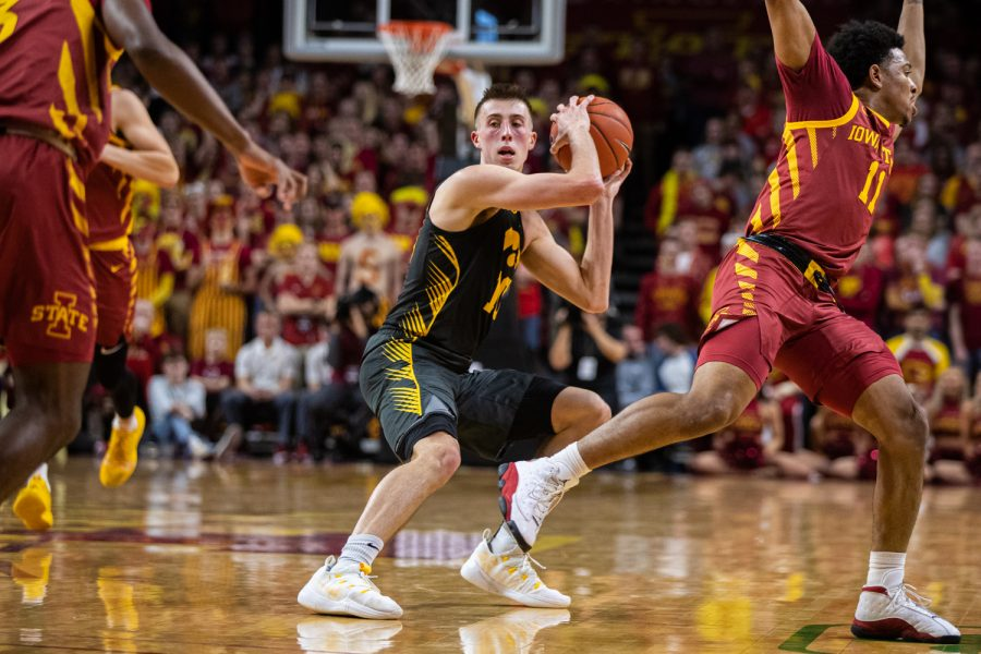 Iowa+guard+Joe+Wieskamp+looks+to+pass+during+a+men%C3%95s+basketball+match+between+Iowa+and+Iowa+State+at+Hilton+Coliseum+on+Thursday%2C+Dec.+12%2C+2019.+Wieskamp+made+5-of-10+shots+on+the+night.