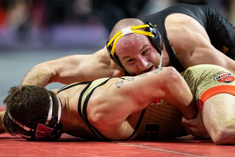 Iowa's 165-pound Alex Marinelli wrestles Wisconsin's Joshua Otto during the first session of the 57th Annual Ken Kraft Midlands Championships at the Sears Centre in Hoffman Estates, IL, on Sunday, Dec. 29, 2019. Marinelli won by a fall in 1:17.