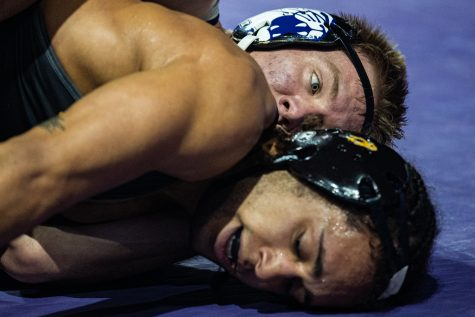 Iowa's 165-pound Jeremiah Moody wrestles Northwestern's Shayne Oster during the first session of the 57th Annual Ken Kraft Midlands Championships at the Sears Centre in Hoffman Estates, IL, on Sunday, Dec. 29, 2019. Oster won by major decision, 13-5.