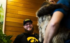 Iowa offensive lineman Levi Paulsen laughs looking at a two-toed sloth during the teams visit of the San Diego Zoo on Wednesday, December 25, 2019.