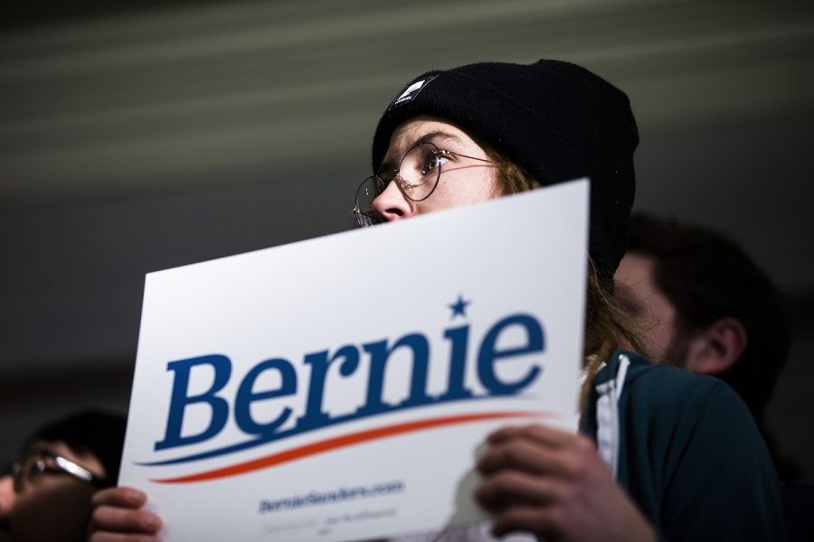 An attendee holds up a sign during the Iowa City Climate Rally held by Sen. Bernie Sanders, I-Vt., at the Graduate hotel on Sunday, January 12, 2020. Sanders discussed his climate policies, the impact of climate change, the Green New Deal, and the dangers of climate inaction in the government.