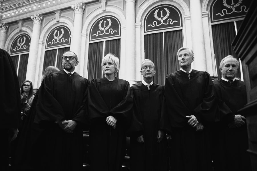 Iowa Supreme Court Justices stand during the Condition of the State address at the Iowa State Capitol on Jan. 14.