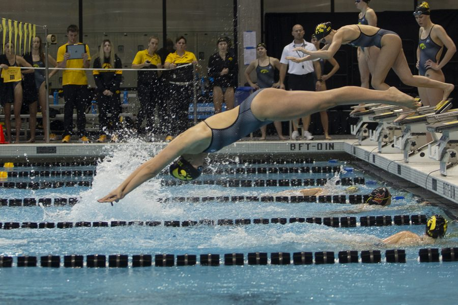 Iowa%E2%80%99s+Hannah+Burvill+dives+off+the+blocks+in+the+400+Freestyle+Relay+during+a+swim+meet+at+the+Campus+Recreation+and+Wellness+Center+between+Iowa+and+Rutgers+on+Nov.+8%2C+2019.