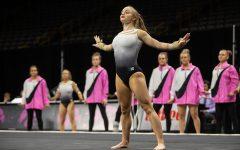 Iowa gymnast Lauren Guerin performs her floor routine during the Gymhawks' home opener on Jan. 11 at Carver-Hawkeye Arena.