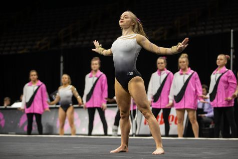 Iowa gymnast Lauren Guerin performs her floor routine during the Gymhawks
