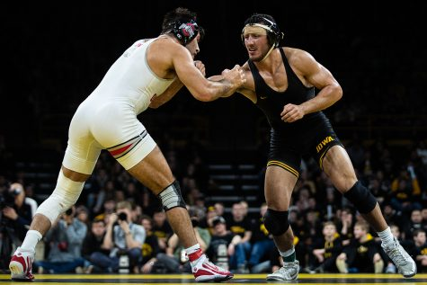 Iowa's 174-pound Michael Kemerer wrestles Ohio State's Kaleb Romero during a wrestling dual meet between No. 1 Iowa and No. 4 Ohio State at Carver-Hawkeye Arena on Friday, Jan. 24, 2020. No. 2 Kemerer defeated No. 8 Romero by decision, 6-1, and the Hawkeyes defeated the Buckeyes, 24-10.