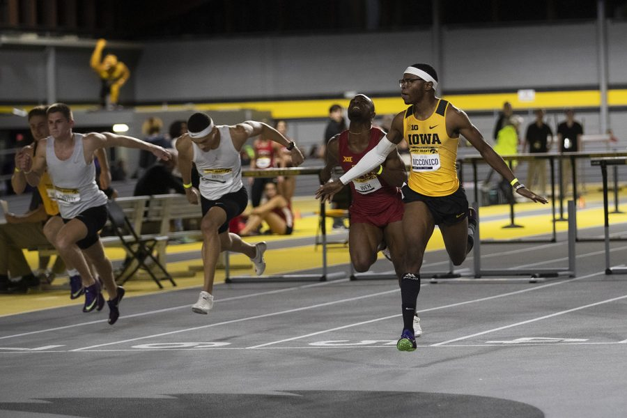 Iowa hurdler Jaylan McConico crosses the finish line of the men's 60m hurdles during the Jimmy Grant Invitational at the University of Iowa Recreation Building on Saturday, Dec. 14, 2019. McConico's final time of 7.66 won him the race over teammates Josh Braverman and Will Daniels.
