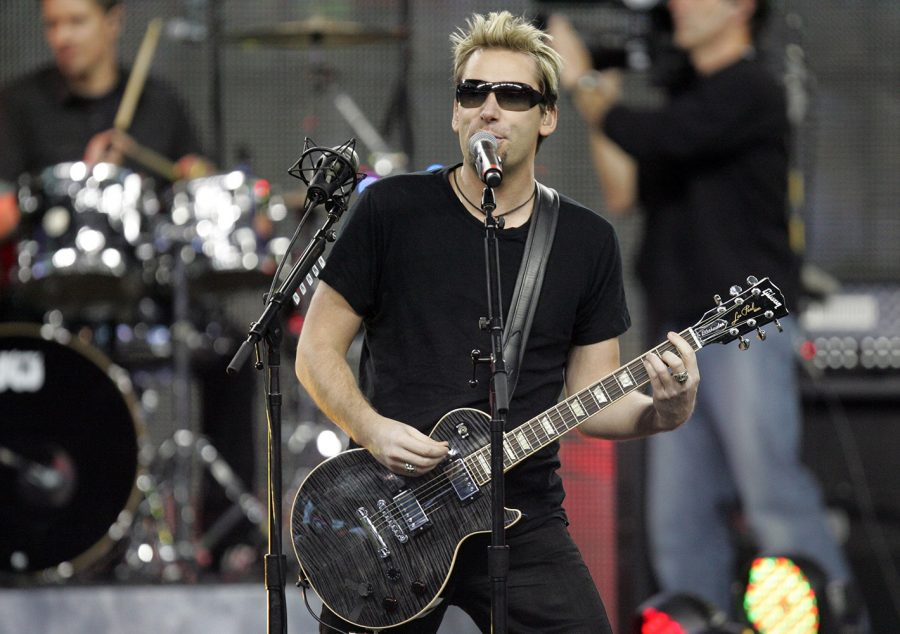 Nickleback lead singer Chad Kroeger performs during half time of the Thanksgiving Day game between the Detroit Lions and Green Bay Packers at Ford Field in Detroit, Michigan, Thursday November 24, 2011. (Kirthmon F. Dozier/Detroit Free Press/MCT)