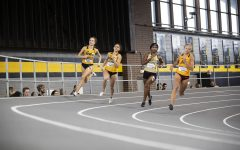 Iowa's Payton Wensel and Tia Saunders compete in the women's 400m dash during the fourth annual Larry Wieczorek Invitational at the University of Iowa Recreation Building on Saturday, Jan 18, 2020.