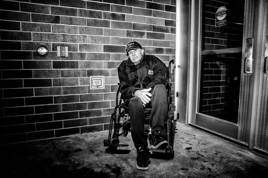 Norman Lettington, a U.S. Army veteran sits in a wheelchair outside of the VIP entrance outside of a rally for President Donald Trump at the Knapp Center on Thursday, January 30, 2020. Hundreds of individuals including supporters, protestors, and members of the press were left outside after the event reached maximum capacity, including Lettington. Lettington is diagnosed with Alzheimer's and has a few months left of life. Currently being treated in the veteran's unit in the hospital, he cannot make most trips out to the public. Lettington traveled to the event in hope of seeing President Trump in person.