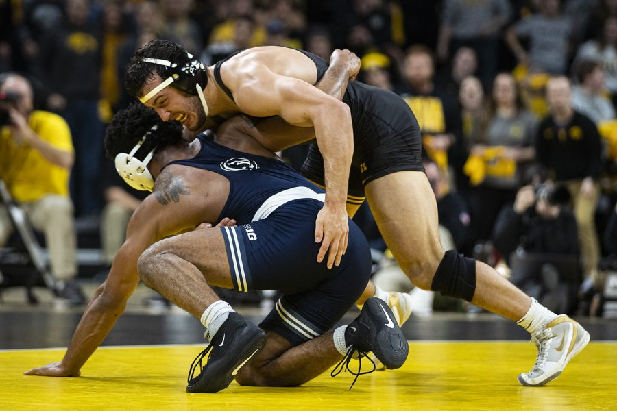 Iowas 174-pound Michael Kemerer wrestles Penn States Mark Hall during a wrestling dual meet between No. 1 Iowa and No. 2 Penn State at Carver-Hawkeye Arena on Friday, Jan. 31, 2020. No. 2 Kemerer defeated No. 1 Hall by decision, 11-6, and the Hawkeyes defeated the Nittany Lions, 19-17. (Shivansh Ahuja/The Daily Iowan)