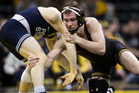 Iowa's Spencer Lee wrestles Penn State's Brandon Meredith during a wrestling dual meet between No. 1 Iowa and No. 2 Penn State at Carver-Hawkeye Arena on Friday, Jan. 31, 2020.