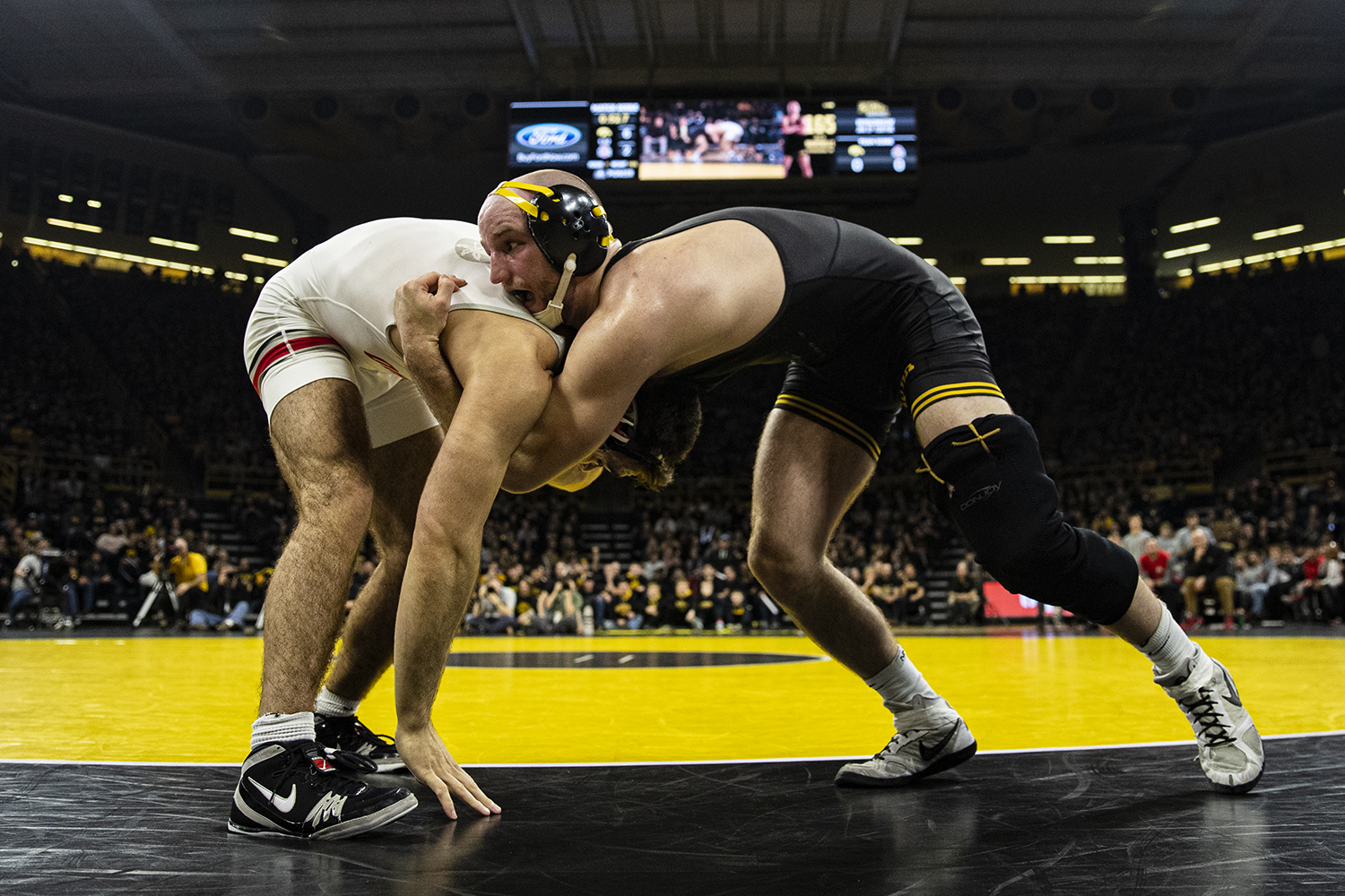 IowaÕs 165-pound Alex Marinelli wrestles Ohio StateÕs Ethan Smith during a wrestling dual meet between No. 1 Iowa and No. 4 Ohio State at Carver-Hawkeye Arena on Friday, Jan. 24, 2020. No. 2 Marinelli defeated No. 13 Smith by decision, 14-10.