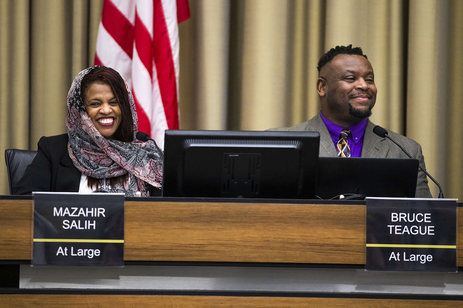 Mayor Pro Tem Mazahir Salih (left) and Mayor Bruce Teague smile after being sworn in during the City Council meeting at Iowa City City Hall on Thursday, Jan. 2, 2020. The city councilors also voted on appointments for a number of city commissions.