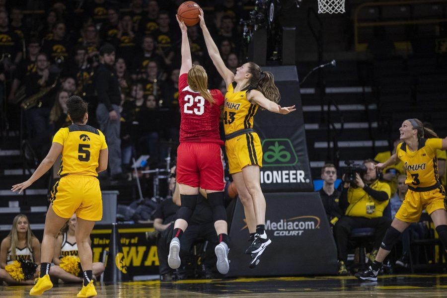 Iowa forward Amanda Ollinger blocks Ohio State forward Logan Cook during Iowa women's basketball vs. Ohio State in Carver-Hawkeye Arena on Thursday. The Hawkeyes defeated the Buckeyes, 77-68.