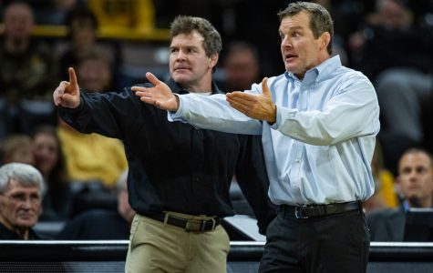 Iowa extends contracts for Tom Brands, two assistants