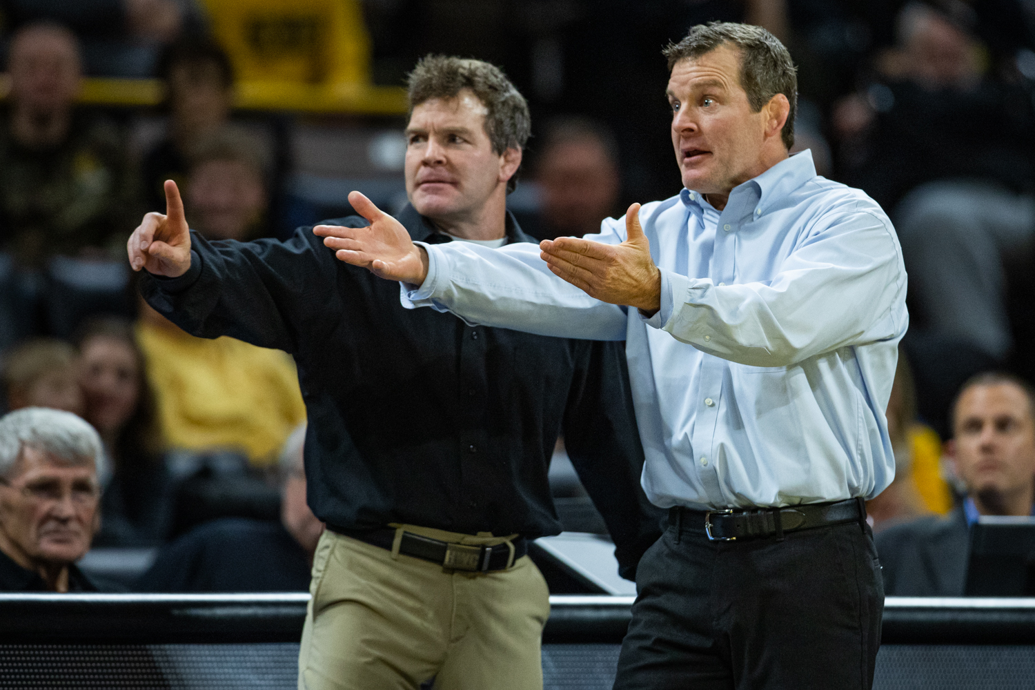 Iowa coaches Terry (left) and Tom Brands gesture toward the officials during a wrestling dual meet between Iowa and Nebraska at Carver-Hawkeye Arena on Saturday, Jan. 18, 2020. The Hawkeyes defeated the Huskers, 26-6.