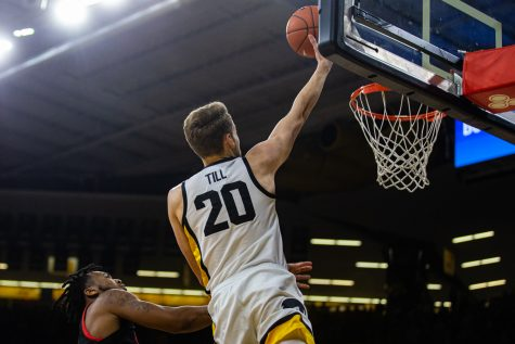 Iowa forward Riley Till takes a shot during a men