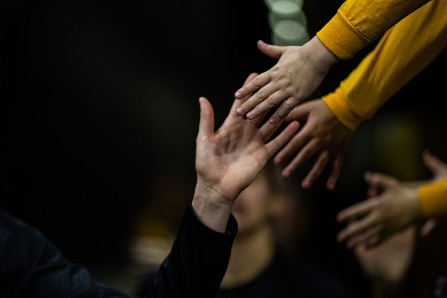 Iowa+players+high-five+young+fans+during+a+women%E2%80%99s+basketball+game+between+Iowa+and+Maryland+at+Carver-Hawkeye+Arena+on+Thursday%2C+Jan.+9%2C+2020.+The+Hawkeyes+defeated+the+Terrapins%2C+66-61.