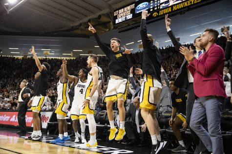 Members of the Iowa men's basketball team react to the game during a men's basketball game between the Iowa Hawkeyes and the Illinois Fighting Illini on Sunday, February 2, 2020. The Hawkeyes defeated the Fighting Illini 72-65.