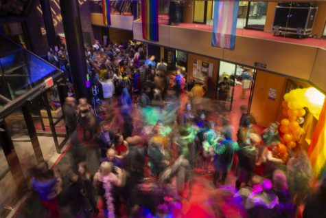 Attendees are seen at the Stonewall 50th Anniversary Celebration held in the Theatre Building on Friday, Jan. 31, 2020. After the opening performance of Hit the Wall at Hancher Auditorium, audience members were encouraged to join in on the celebrations to commemorate the 50th anniversary of the riots that sparked the LGBTQ+ movement. (Hannah Kinson/The Daily Iowan)