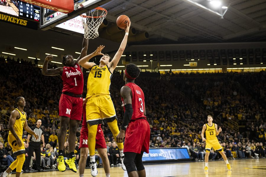 Iowa forward Ryan Kriener goes in for the shot while Nebraska Guard Kevin Cross attempts to block during a men's basketball game between the Iowa Hawkeyes and the Nebraska Huskers at Carver-Hawkeye arena on Saturday, February 8, 2020. The Hawkeyes defeated the Huskers 96-72.