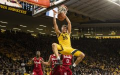 Iowa center Luka Garza dunks the ball during a men's basketball game between the Iowa Hawkeyes and the Nebraska Huskers at Carver-Hawkeye arena on Saturday, February 8, 2020. The Hawkeyes defeated the Huskers 96-72.