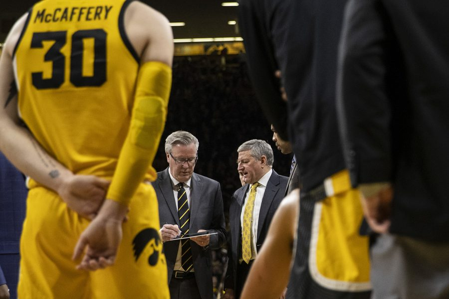 Iowa head coach Fran McCaffrey and assistant coach Kirk Speraw discuss strategy during a timeout during a men's basketball game between the Iowa Hawkeyes and the Nebraska Huskers at Carver-Hawkeye arena on Saturday, February 8, 2020. The Hawkeyes defeated the Huskers 96-72.