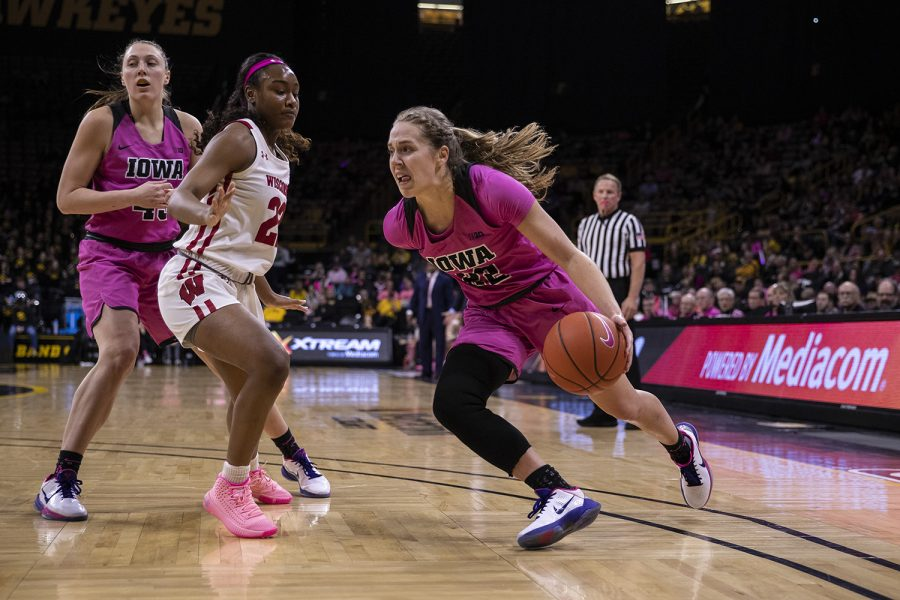 Iowa guard Kathleen Doyle takes the ball to the hoop during a women's basketball between Iowa and Wisconsin at Carver-Hawkeye Arena on Sunday, Feb. 16, 2020. The Hawkeyes defeated the Badgers 97-71.