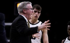 Iowa center Luka Garza looks to Iowa head coach Fran McCaffery during the men's basketball game against Ohio State at Carver-Hawkeye Arena on Thursday, February 20, 2020. The Hawkeyes defeated the Buckeyes 85-76.