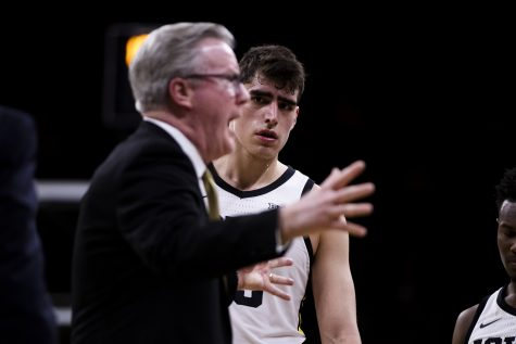 Iowa center Luka Garza looks to Iowa head coach Fran McCaffery during the men