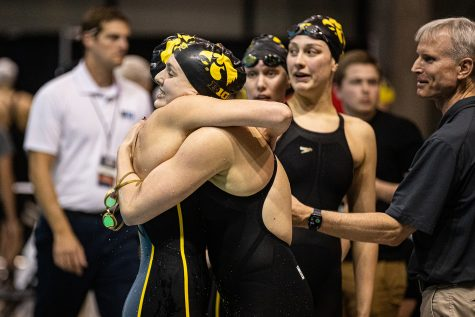 Iowa swimmers embrace each other after the 800 Free Relay during the first session of the 2020 Big Ten Women's Swimming and Diving Championships at the HTRC on Wednesday, Feb. 19, 2020.