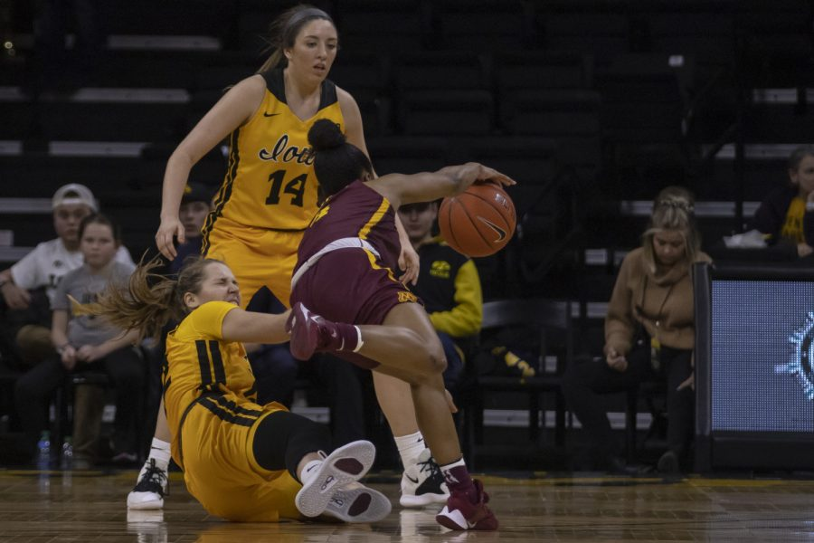 Minnesota guard Jasmine Powell runs into Iowa guard Kathleen Doyle while dribbling the ball during a women's basketball game between Iowa and Minnesota at Carver Hawkeye Arena on Thursday, Feb. 27, 2020. The Hawkeyes defeated the Gophers, 90-82.