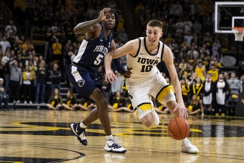 Iowa guard Joe Wieskamp drives the ball past Penn State guard Jamari Wheeler during a men's basketball game between Iowa and Penn State on Saturday, Feb. 29 at Carver-Hawkeye Arena. The Hawkeyes defeated the Nittany Lions 77-68.