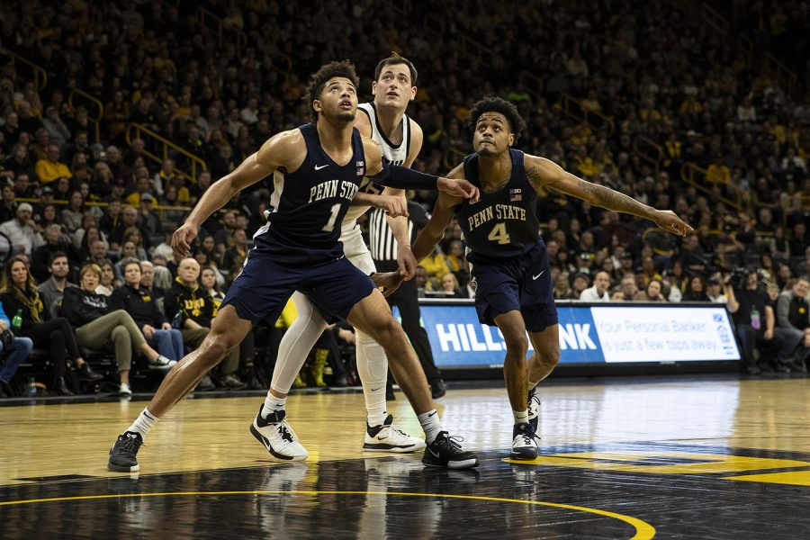 Penn State guards Seth Lundy and Curtis Jones Jr. fight Iowa forward Ryan Kriener for a rebound during a men's basketball game between Iowa and Penn State on Saturday, Feb. 29 at Carver-Hawkeye Arena. The Hawkeyes defeated the Nittany Lions 77-68.