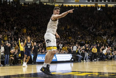 Iowa center Luka Garza celebrates after crossing the 20-point threshold for his fourteenth straight game during a men's basketball game between Iowa and Penn State on Saturday, Feb. 29 at Carver-Hawkeye Arena. The Hawkeyes defeated the Nittany Lions 77-68.