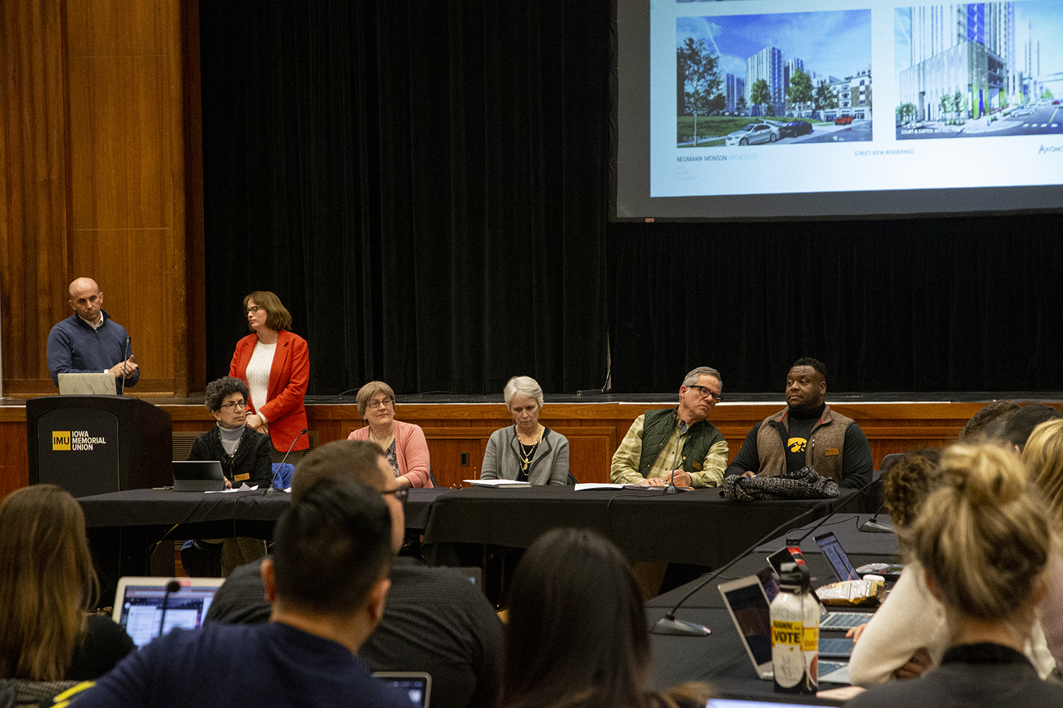 Members of the Iowa City City Council sit before the two UI student governments for a discussion about a proposed development project in downtown Iowa City during a joint meeting on Feb 11.