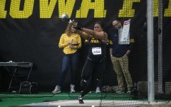 Hawkeye Laulauga Tausago winds up and prepares to throw her weight in the women's weight throwing competition at the Black & Gold Invitational at the Hawkeye Tennis and Recreation Building on Friday, January 31, 2020.