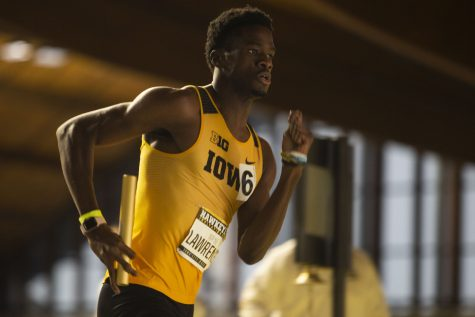 University of Iowa sprinter Wayne Lawrence runs his leg of the 4x400m relay during the Hawkeye Invite at the UI Recreation Building on Jan. 11. He and the other members of the Iowa B relay finished in ninth place.