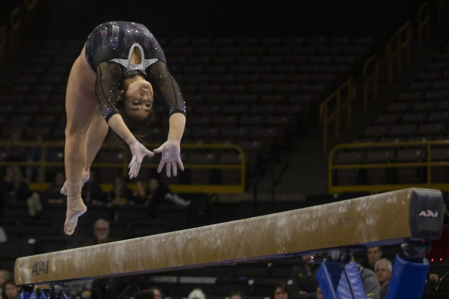 Iowa%E2%80%99s+all-around+Erin+Castle+performs+on+the+beam+during+a+gymnastics+meet+at+Carver-Hawkeye+Arena+against+Michigan+State+on+Feb.+1.+