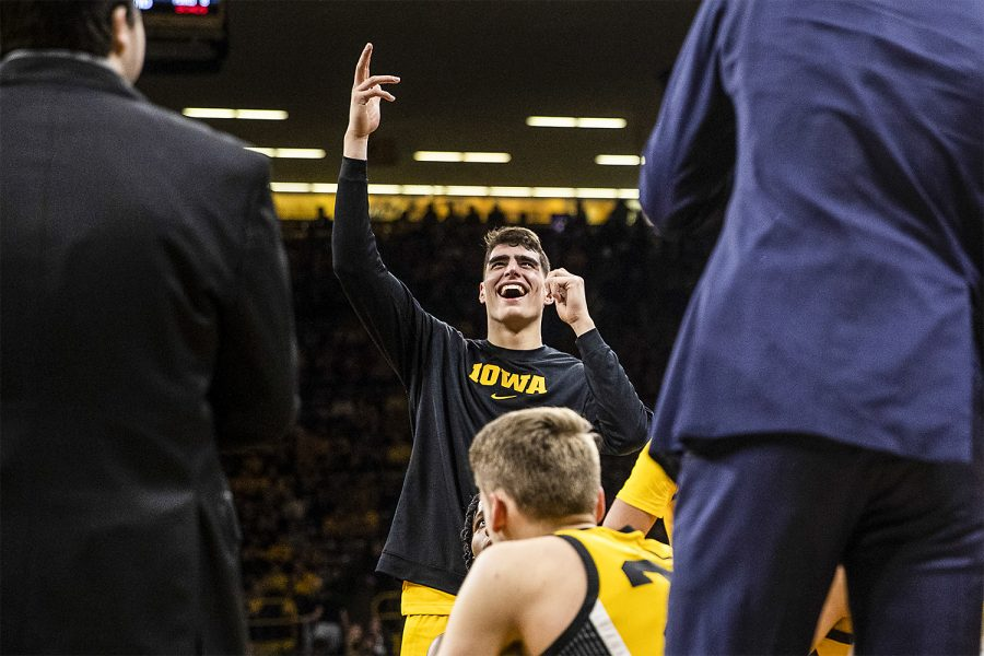 Iowa+center+Luka+Garza+reacts+to+the+highlights+being+shown+on+the+big+screen+during+a+timeout+during+a+men%E2%80%99s+basketball+game+between+the+Iowa+Hawkeyes+and+the+Nebraska+Huskers+at+Carver-Hawkeye+arena+on+Saturday%2C+February+8%2C+2020.+The+Hawkeyes+defeated+the+Huskers+96-72.+