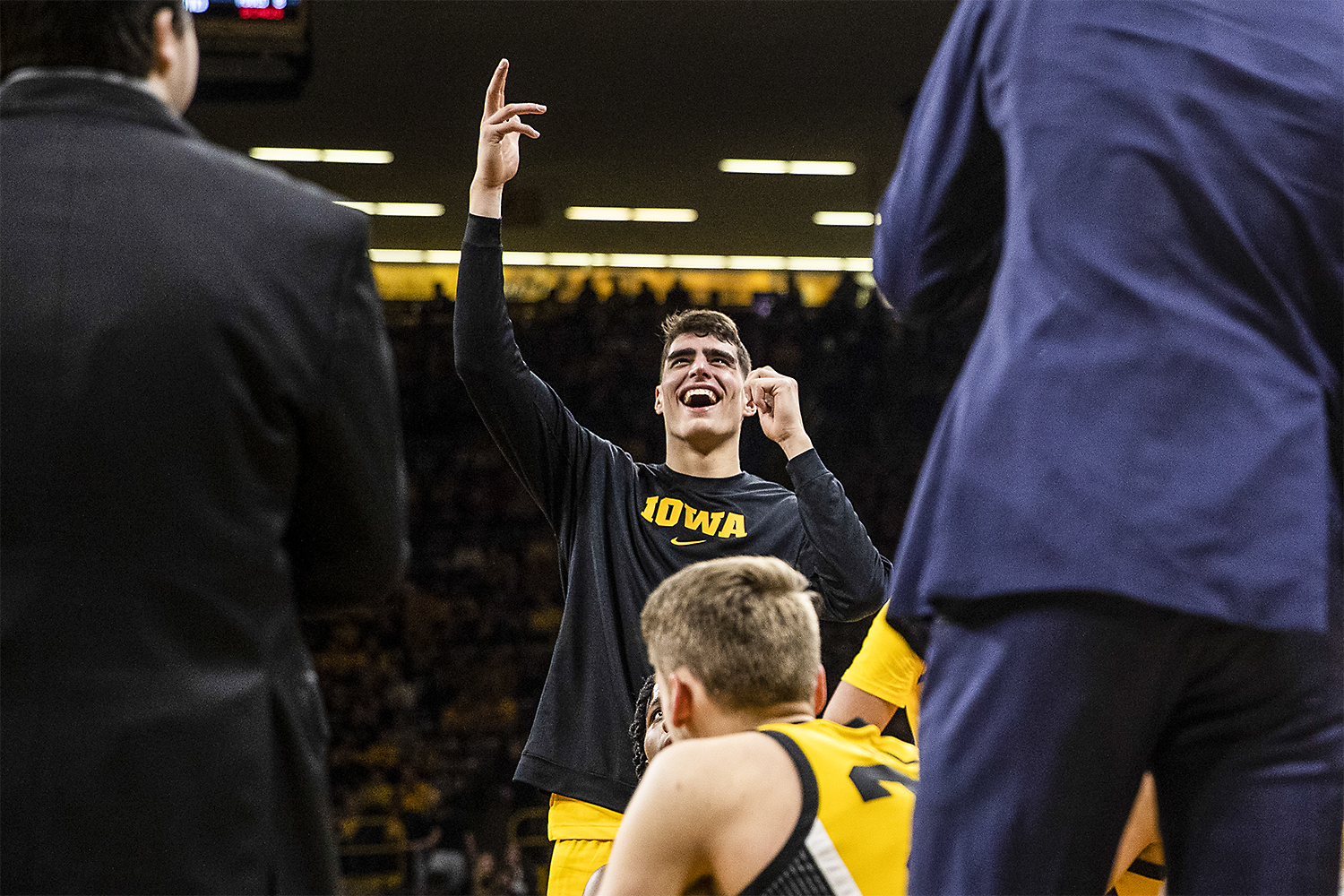 Iowa center Luka Garza reacts to the highlights being shown on the big screen during a timeout during a men's basketball game between the Iowa Hawkeyes and the Nebraska Huskers at Carver-Hawkeye arena on Saturday, February 8, 2020. The Hawkeyes defeated the Huskers 96-72.